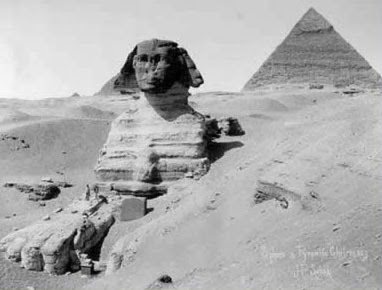 The Giza Sphinx, partially buried in the sand