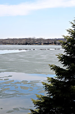 Prior Lake ice off lake frozen spring ice breaking apart Minnesota picture