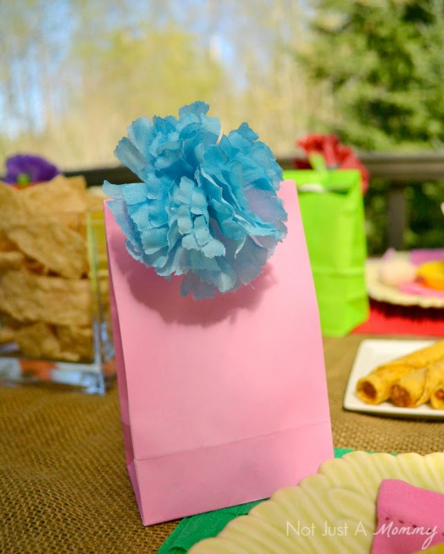 Cinco De Mayo party table flower topped favor bags