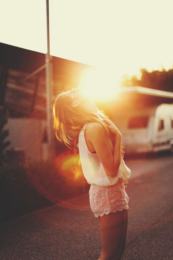 girl laughing at sunset