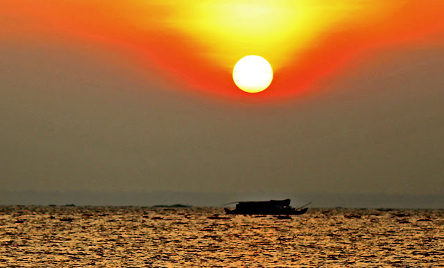 sunset on Lake Vembanad in Kerala, India