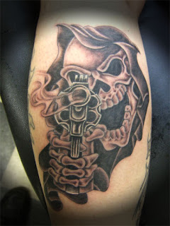gangsta tattoo: Grim Reaper pointing an old-fashioned revolver