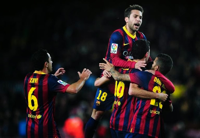 Sergio Busquets celebrating with Barca players