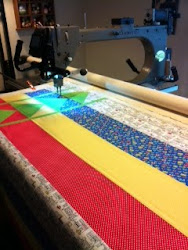 Another one of my quilts on Michelle's frame.  I NEVER get tired of getting pictures like this.