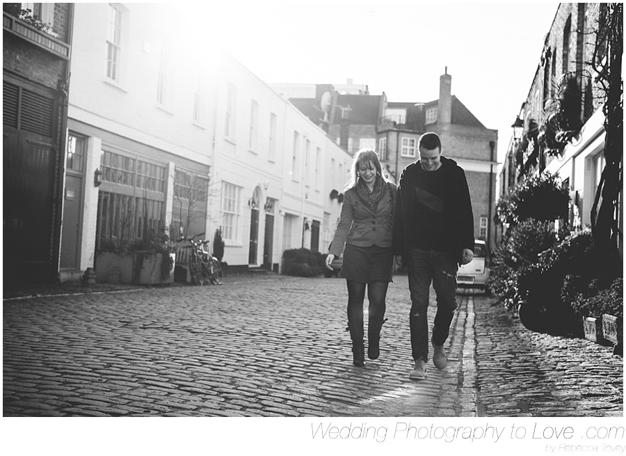 Couple walking down London Street