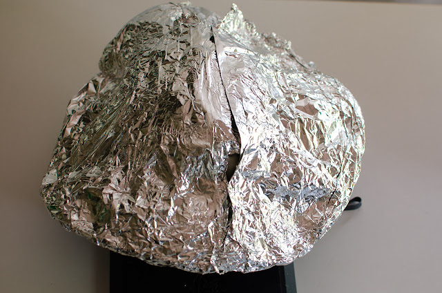 alfoil across sun hat