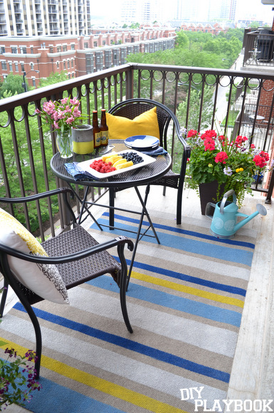 DIY outdoor rug looks amazing on the balcony.