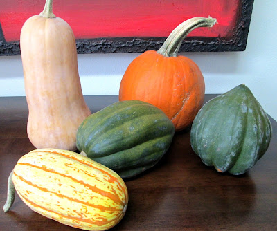 Butternut, acorn, delicata squash and pumpkin on table