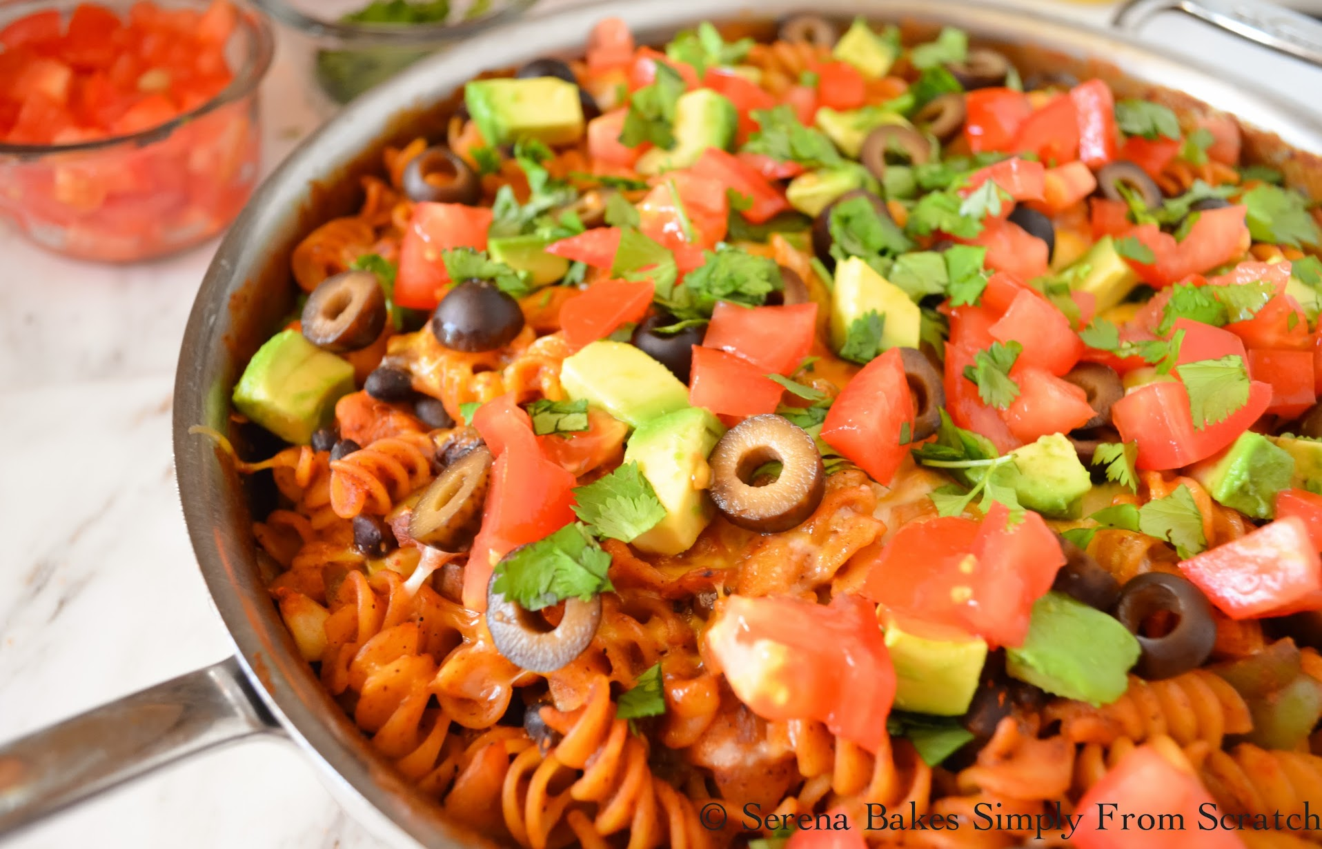 Chicken Enchilada Pasta Skillet with Avocado, Tomatoes, Olives and Cilantro
