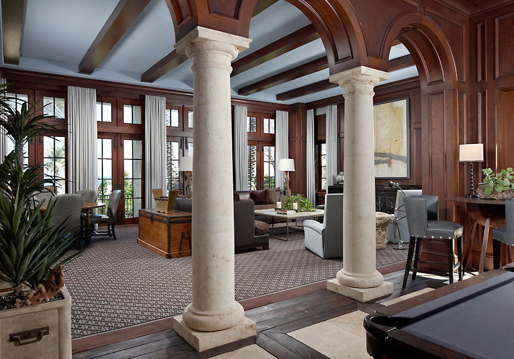 greek column and regal arches highlight the focal points in this joined room