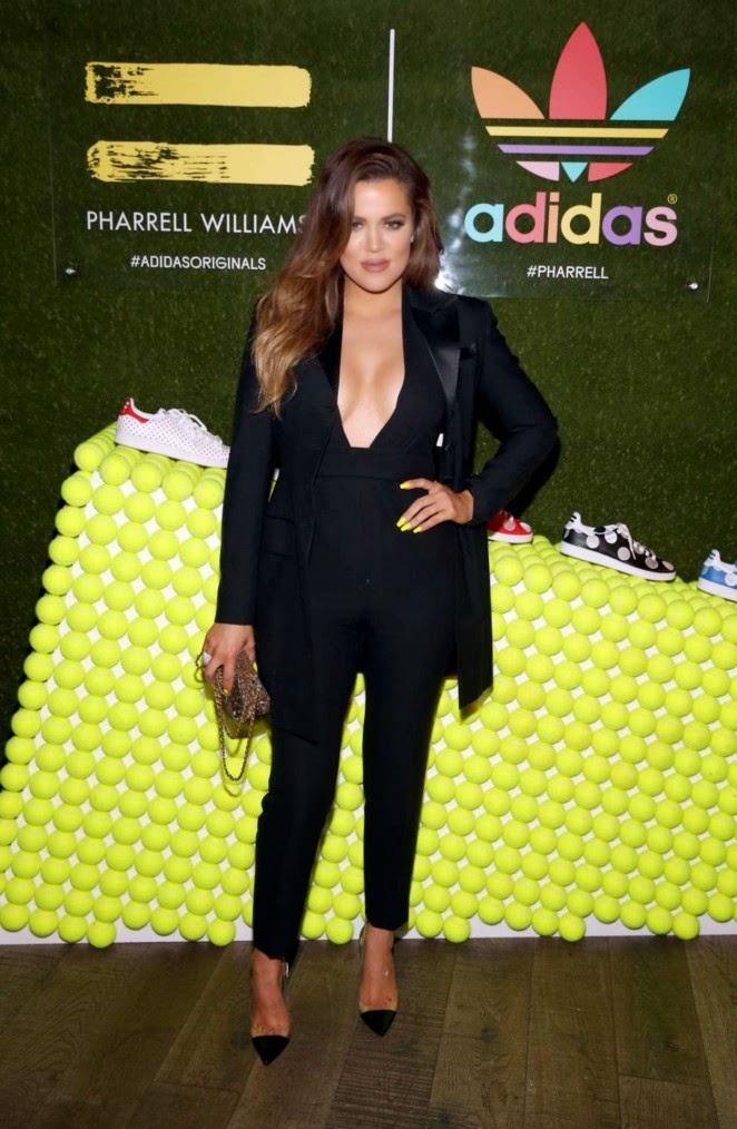 Khloe Kardashian in a plunging catsuit at the Pharell Williams' Adidas Collection Celebration Event in LA