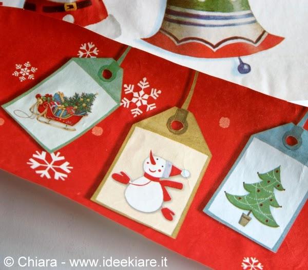 Ritagli di una shopper natalizia per fare biglietti chiudipacco