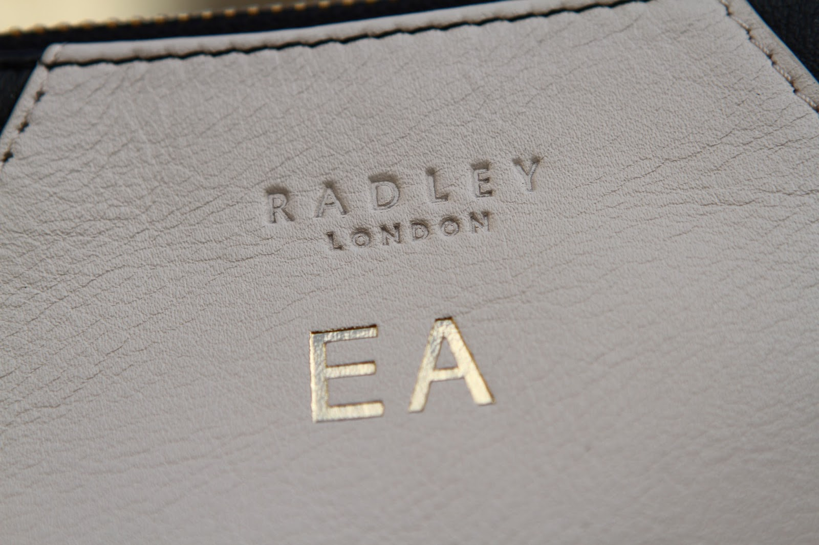 Radley golden square clutch