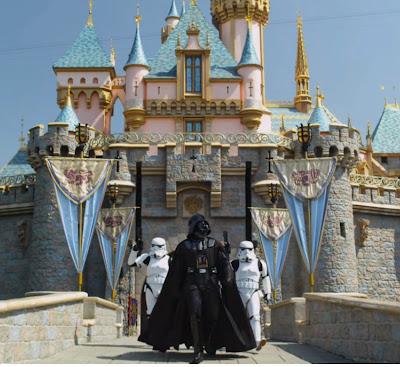 Darth Vader walking out from a castle at Disneyland