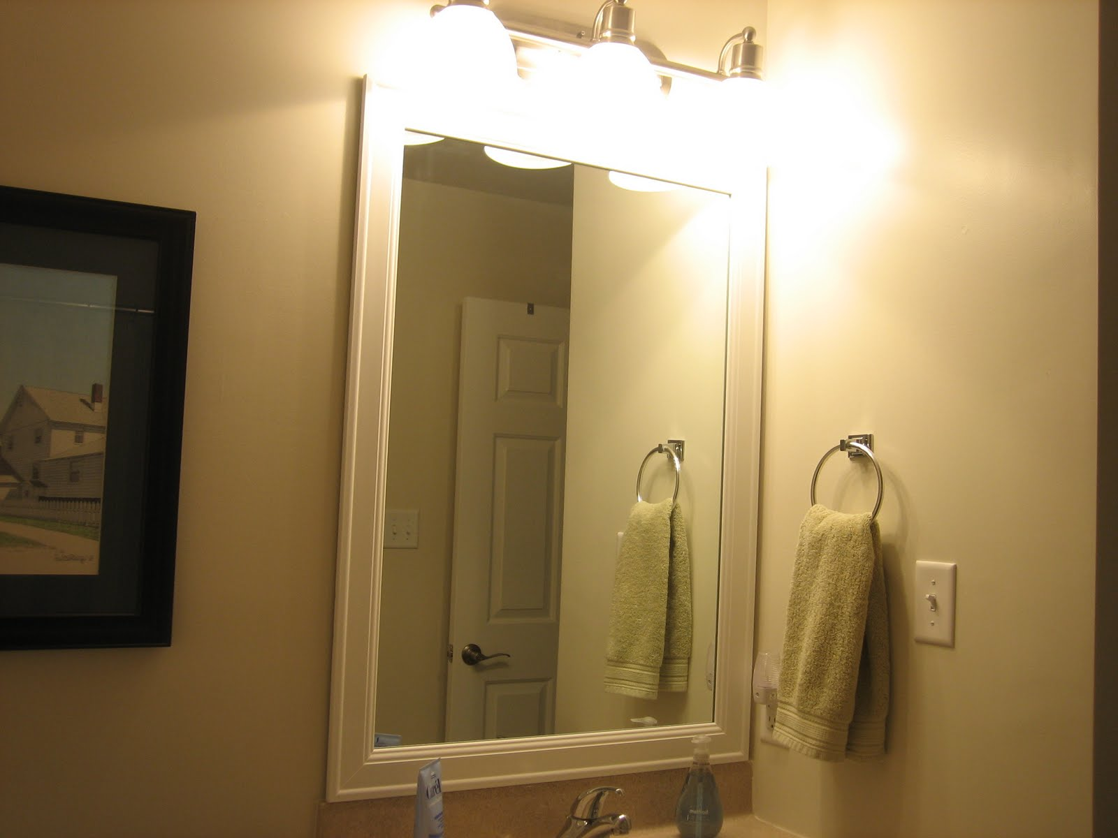 Elizabeth & Co.: Framing Bathroom Mirrors
