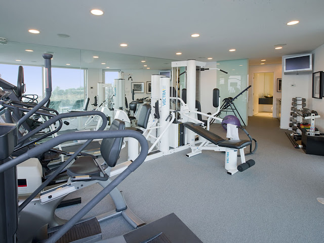Picture of private gym in the basement of modern mansion