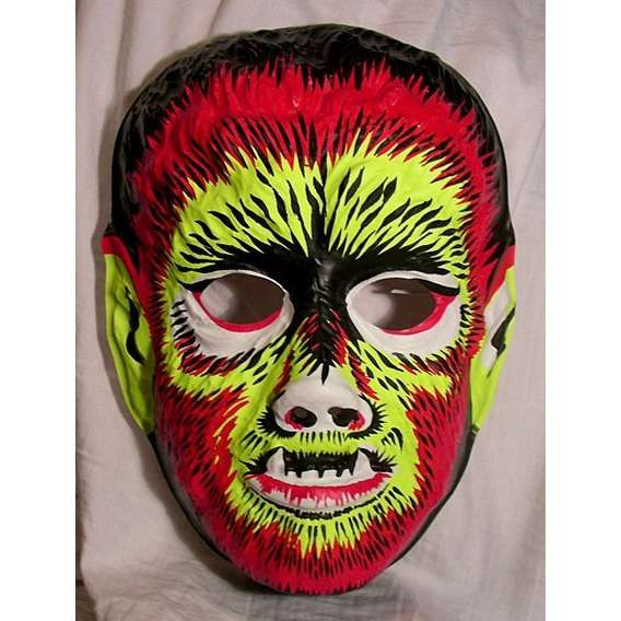 another popular mask for halloween in the 60s and 70s was cardboard ones offered on cereal boxes and other items that you could cut out and attach a string