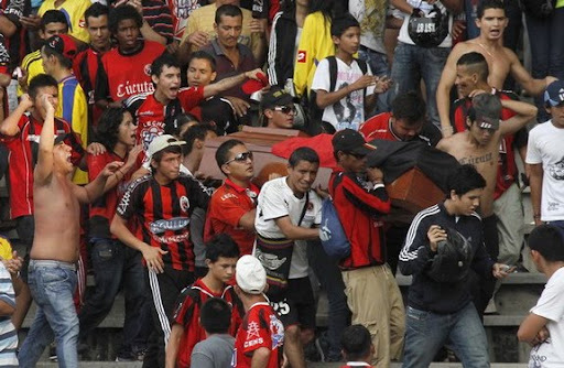 Supporters of Cúcuta Deportivo carry a coffin during a match against Envigado