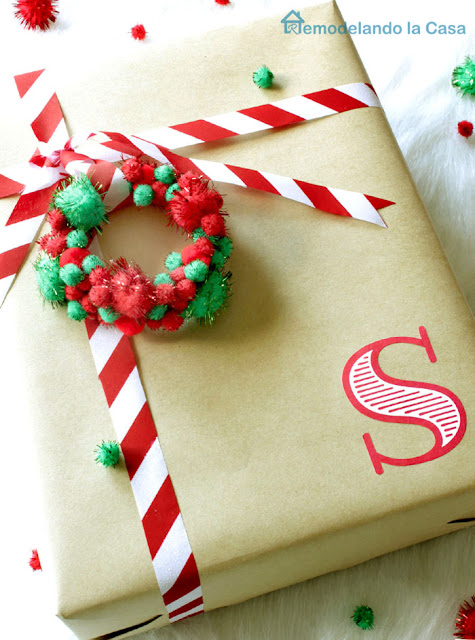 Gift wrapping with brown paper and red and white ribbon