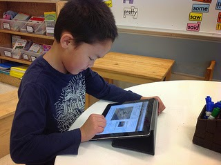 a kid using an iPad