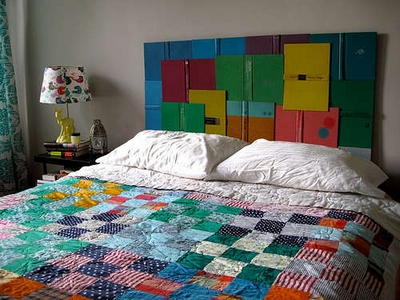 [A colourful book headboard for your bedroom]