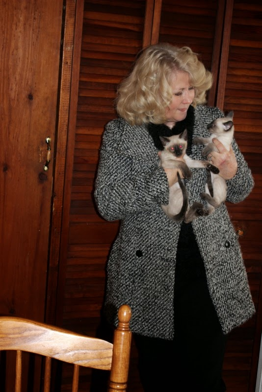 Kathy loves her kittens !
