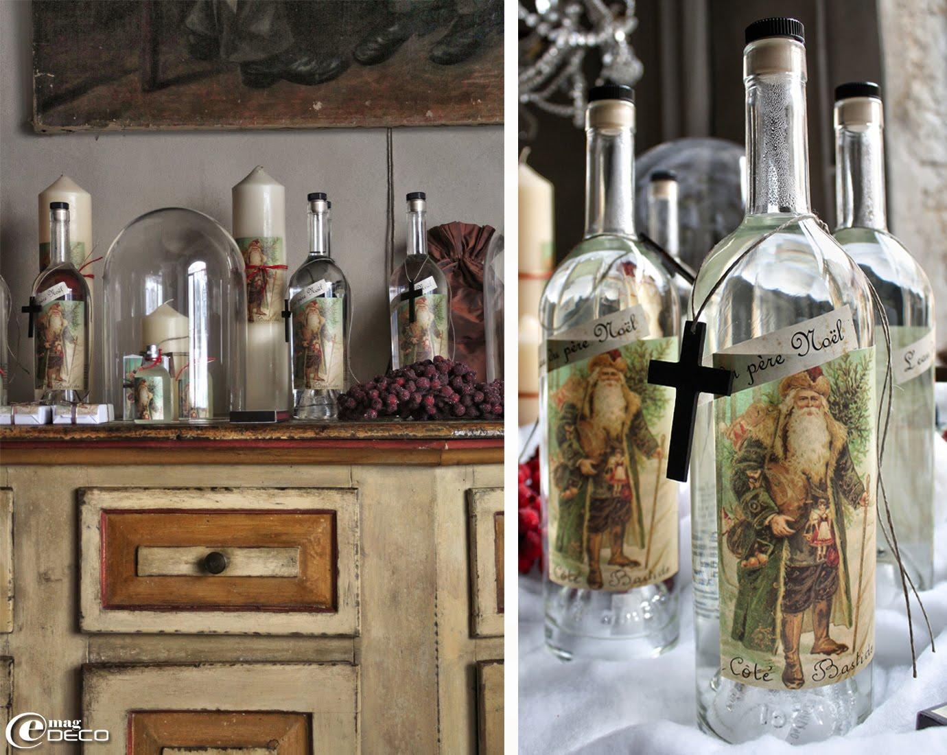 Pour les fêtes, un cierge ivoire Noël et des sprays d'ambiance Noël sont placés sous un globe en verre dans la boutique Côté Bastide.