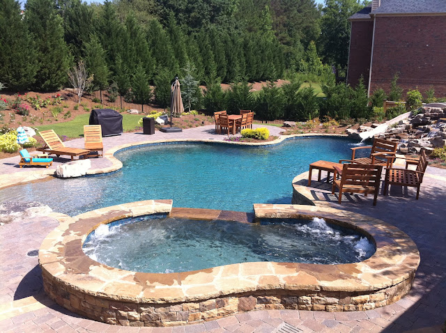 backyard oasis pools free form pool beach entry rock. Black Bedroom Furniture Sets. Home Design Ideas