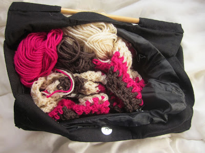 beige, brown and bright pink wool in a bag
