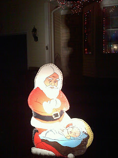 Santa Bowing Down to Baby Jesus yard art