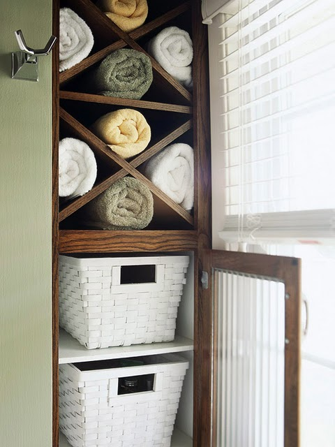 Sorta like a wine rack but for bath towels i think these towels look