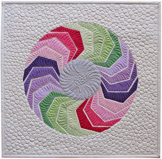http://www.romanianquiltstudio.com/english/color-me-raw-edge-applique-quilt-pattern.html