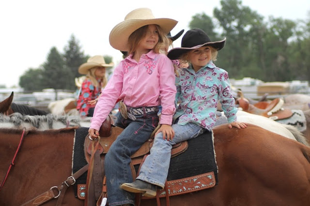 sisters wait on a horse at the Sheridan Elk's Youth Rodeo 2013