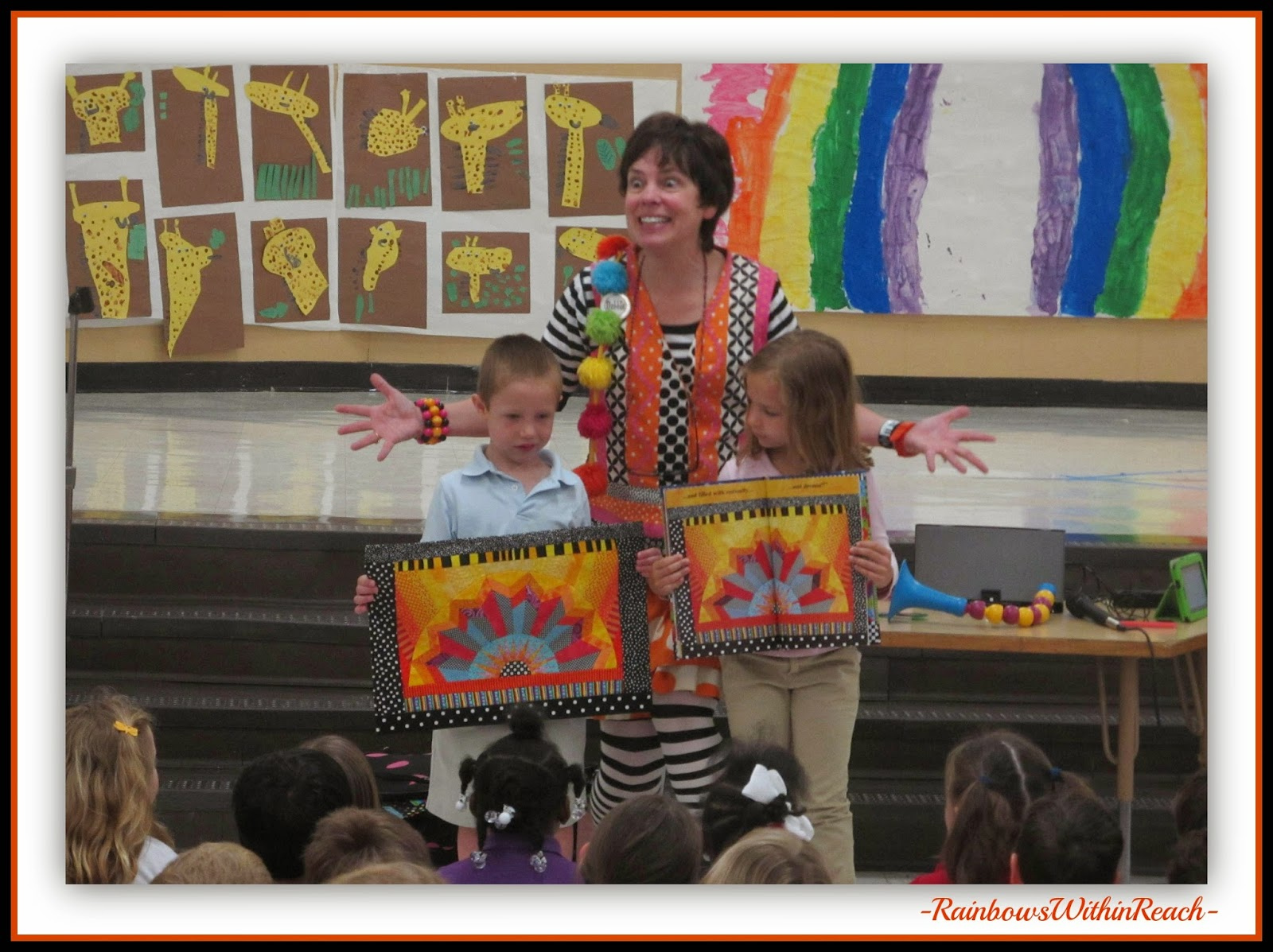 Illustrator Debbie Clement helps Kindergartners compare her original quilt to the finished book's format