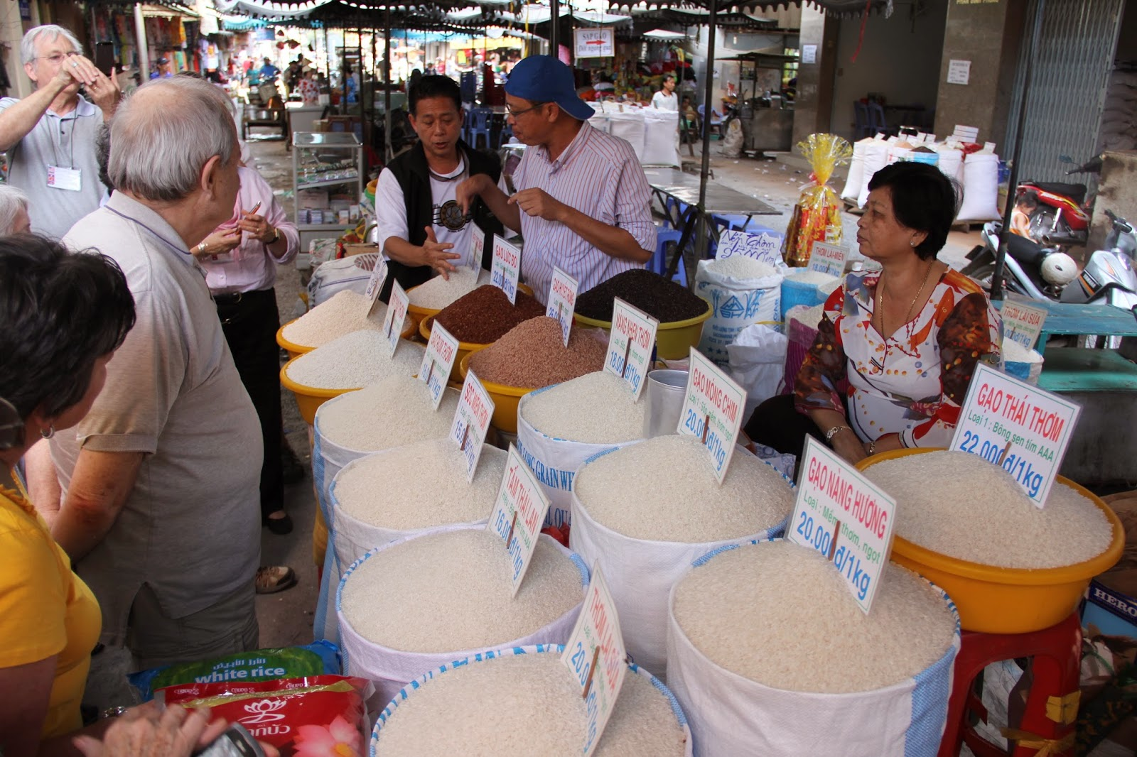 Learning a bit about the wide variety of rice for sale at the Chau Doc market.