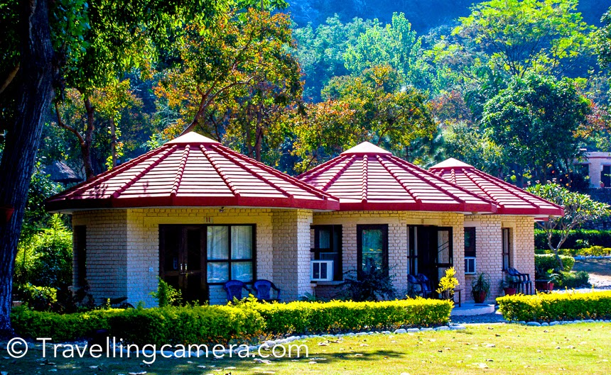 I have been to Jim Corbett 5 times, although I never saw tiger there :). During all my visits to Jim Corebett, I stayed in different resorts and today sharing some of the old photographs from my favorite place so far. This Photo Journey shares about Welcome Heritage Corbett Ramganga resort and more.It was our annual office trip and we reached this resort early in the morning after overnight journey in Volvo from Delhi. This place is located around Ramganga river. This resort has huge space surrounded by green trees, colorful birds and lot of flora & fauna. There are different sorts of cottages, rooms and suites in this resort. Nicely maintained rooms and facilities. We spent 2 days in this resort and it was an awesome experience for most of us. During these 2 days, we also planned one safari inside Jim Corbett National Park.I loved these huts in woods. This resort has huge area and some part of it is well covered with trees and varied plantations. This place is away from hustle bustle of the town. Main town is full of resorts, while this one is away from main road and no other resort or hotel around this place.The resort is located at stunning location right between valleys and ramganga river. Very peaceful and mesmerizing. It's near marchulla and even the roads leading to resort give you feeling that something is special in its location.We had a fantastic time staying at Ramganga resort. I have never had such fresh n well made food in a hotel. We used to eat like crazy, and none of us complained of any sort of gastric problems.The hotel staff was very courteous.Some of the folks in our group felt that cottages lacked a bit of privacy.Early morning time was such a pleasant experience in this resort, waking up, to the sound of water n birds chirping. Dew on the flowers make their gardenThe staff here are amazing set of people who are really helpful and not the ones who head to please only the foreign tourists.  Since we were there in a group, the package we got from 