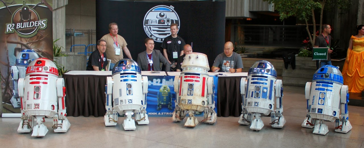 Pacific NW R2 Builders Club astromech droids all lined up.  Lego R2-D2 on right.