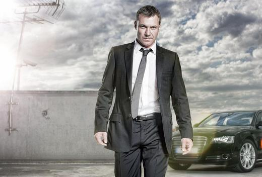 Transporter: The Series Transporter_the_TV_series_Cinemax_Europacorp_Chris_Vance_in_suit_and_tie_with_Audie_A8_Luc_Besson_Stephen_Williams_promotional_image
