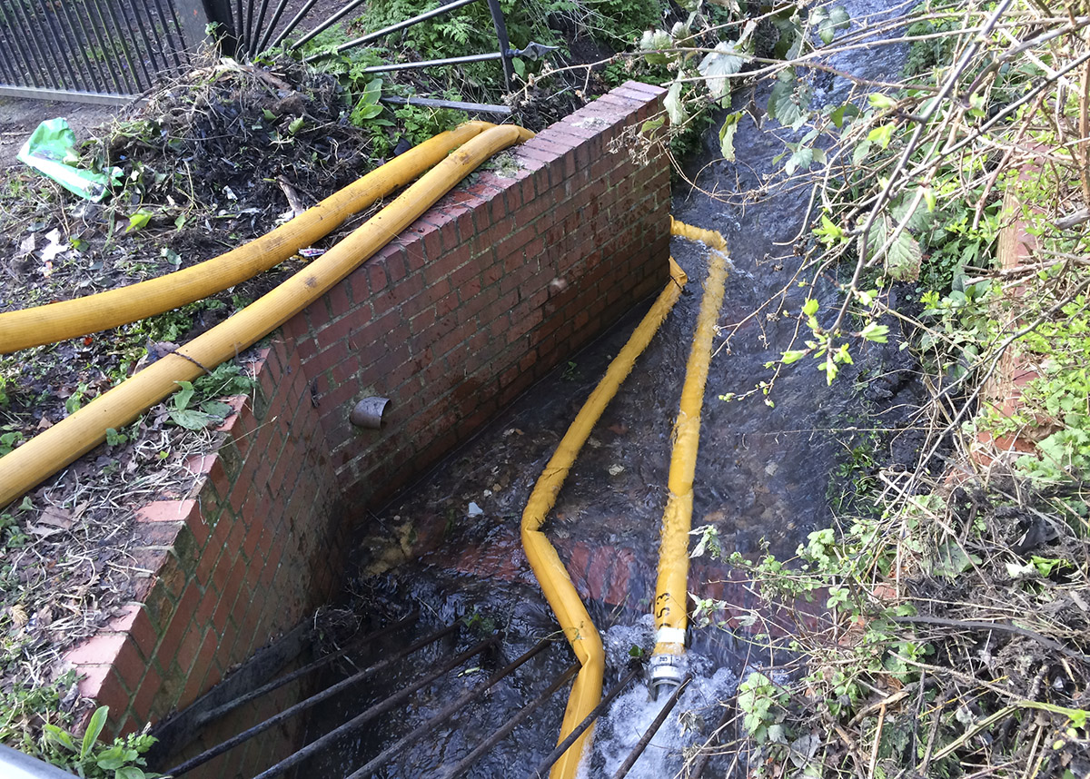 Water being pumped into a stream in Summer Grove.  23 February 2014.