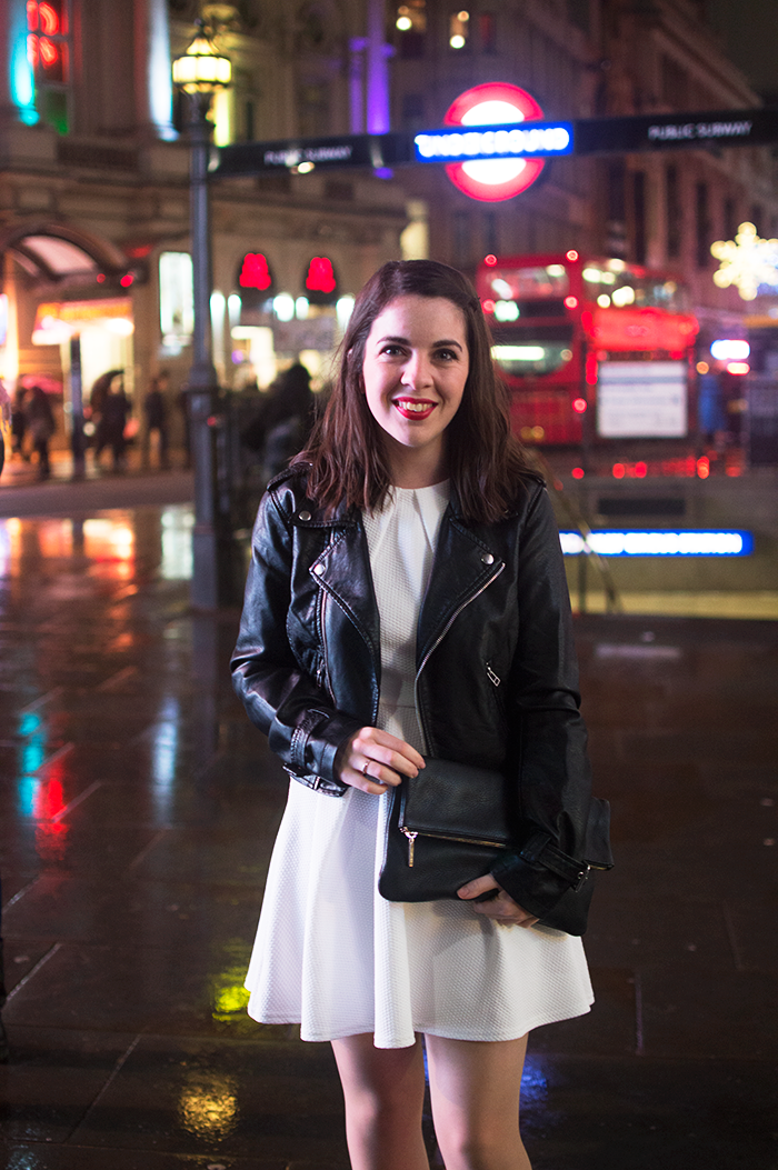 How to wear a black clutch bag in London