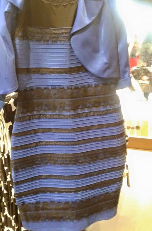 A photo of a dress that could be a blue and black dress in bright light or a white and gold dress in deep shadow.