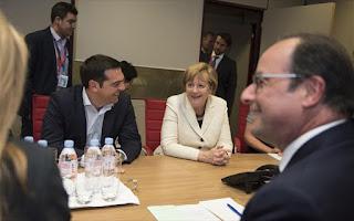 Η καγκελάριος της Γερμανίας Άγκελα Μέρκελ με τον πρόεδρο της Γαλλίας Φρανσουά Ολάντ και το πρωθυπουργό Αλέξη Τσίπρα