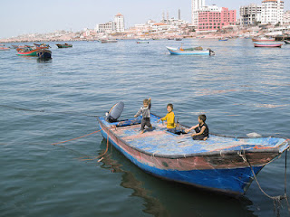 Fishing activities, fisher folk in boat on water coastal regulation zone notification provisions