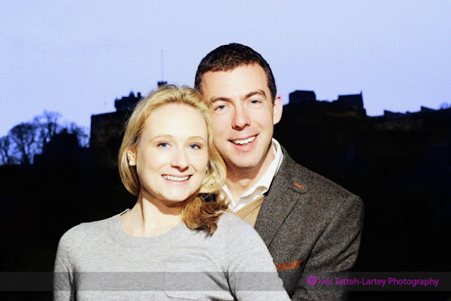 A portrait of bride and groom to be, with the dominent Edinburgh Castle in the background.