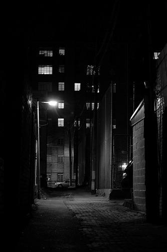 alone in a dark alley