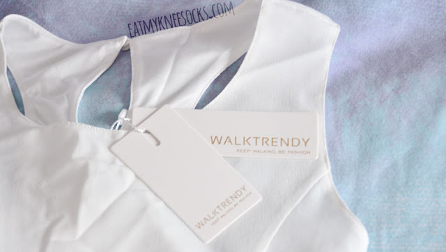 WalkTrendy's white high-low dress has unique cutouts on the front and the back.