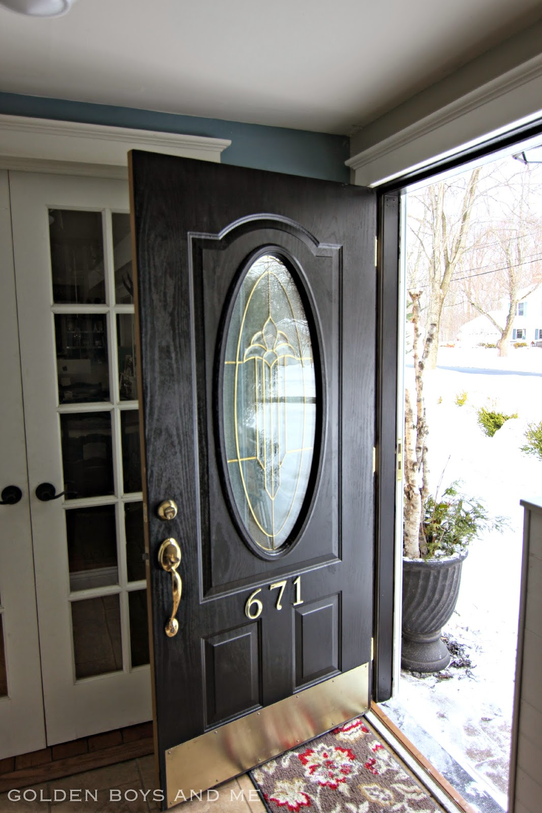 Front Door makeover with black paint and brass hardware-www.goldenboysandme.com
