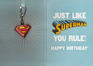Interior of Superman birthday card with backpack pull tag from Hallmark