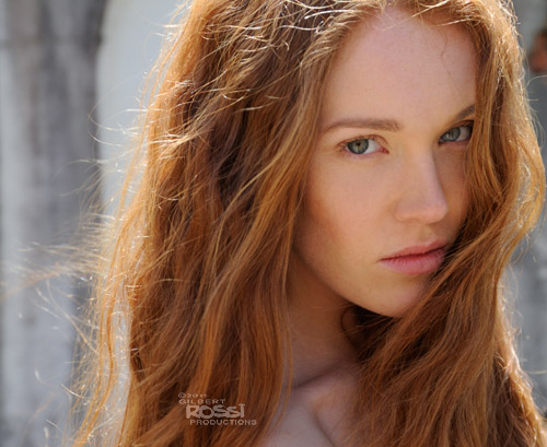 fashion photography in street by sydney photographer gilbert rossi, shooting model on location with natural light, gorgeous redhead shot on location by sydney photographer gilbert rossi