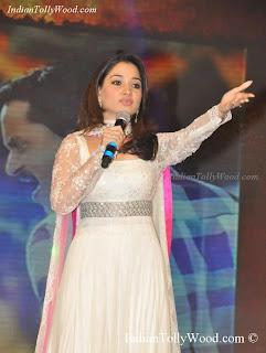 Tamanna Photos in White Dress At Tadakha Audio Launch